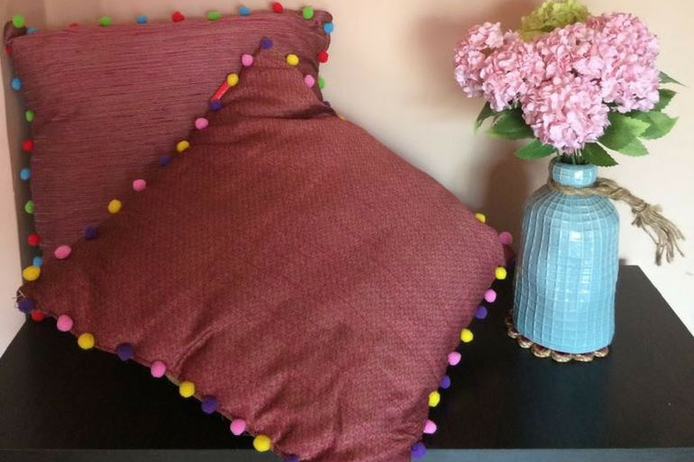 Get Cushiony with Colourful Pom Poms